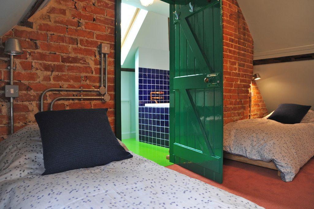 Attic dorm - sleeping area and en suite bathroom