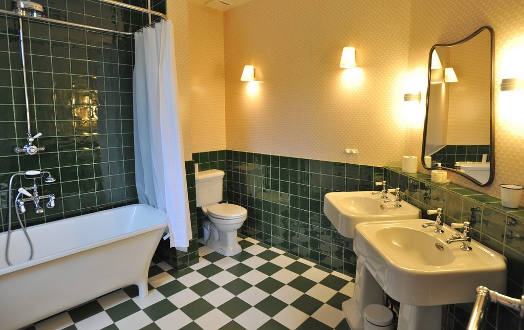 En suite bathroom (to Blue bedroom) with bath and shower over