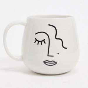 white ceramic mug with abstract face print