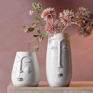 white ceramic vases with face design