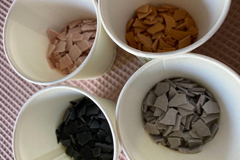 four cups from the top of different colours terrazzo chips