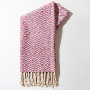 pink throw made from recycled materials