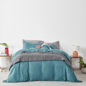 teal linen bedding with grey throw