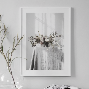 framed photo of flowers on table