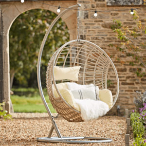 natural cocoon chair in english country garden