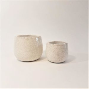 Two small plant pots with a cream crackle glaze finish