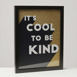 black and gold typography poster in black frame
