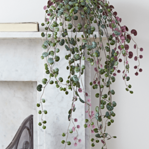 artificial string of hearts on mantlepiece