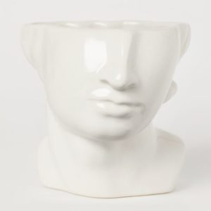 vase in shape of lower half of a greek statue's face