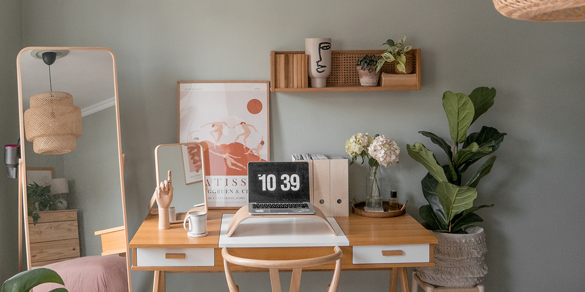 an office desk and styling accents in the corner of a bedroom