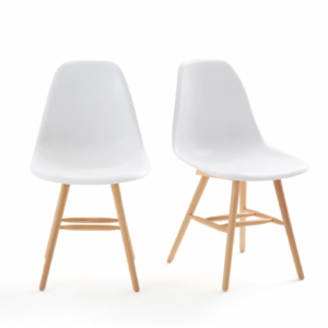two white plastic bucket chairs