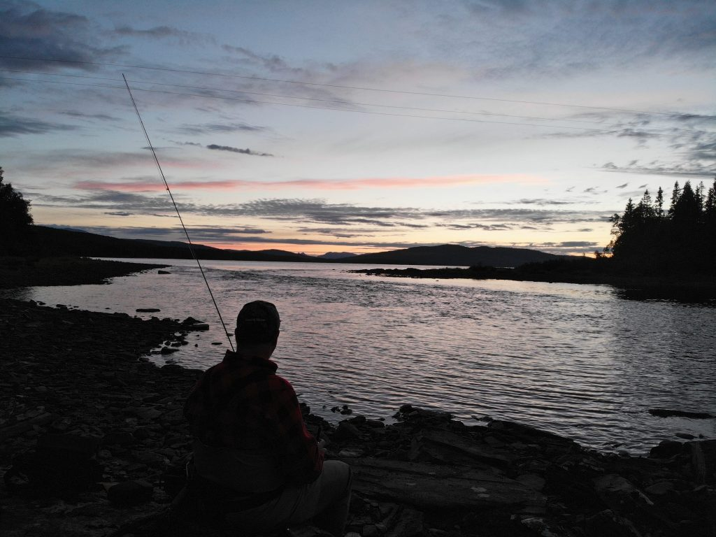 Waiting for the hatch Fly Angler fishing for trout and Arctic char at Skålestrømmen Norway