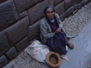 Old woman begging for money in Cuzco