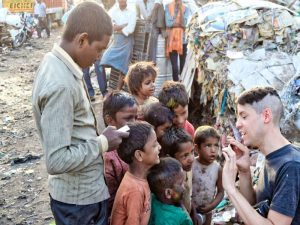 Volunteer tourism taking pictures of poor children