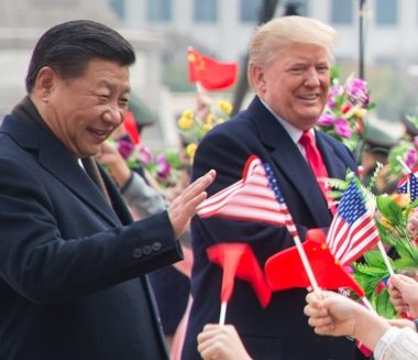Presidents Xi and Trump greeting people with flags