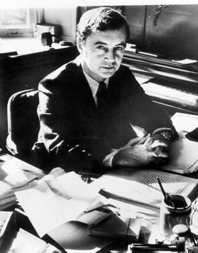 A picture of sociologist Erving Goffman sitting at his desk