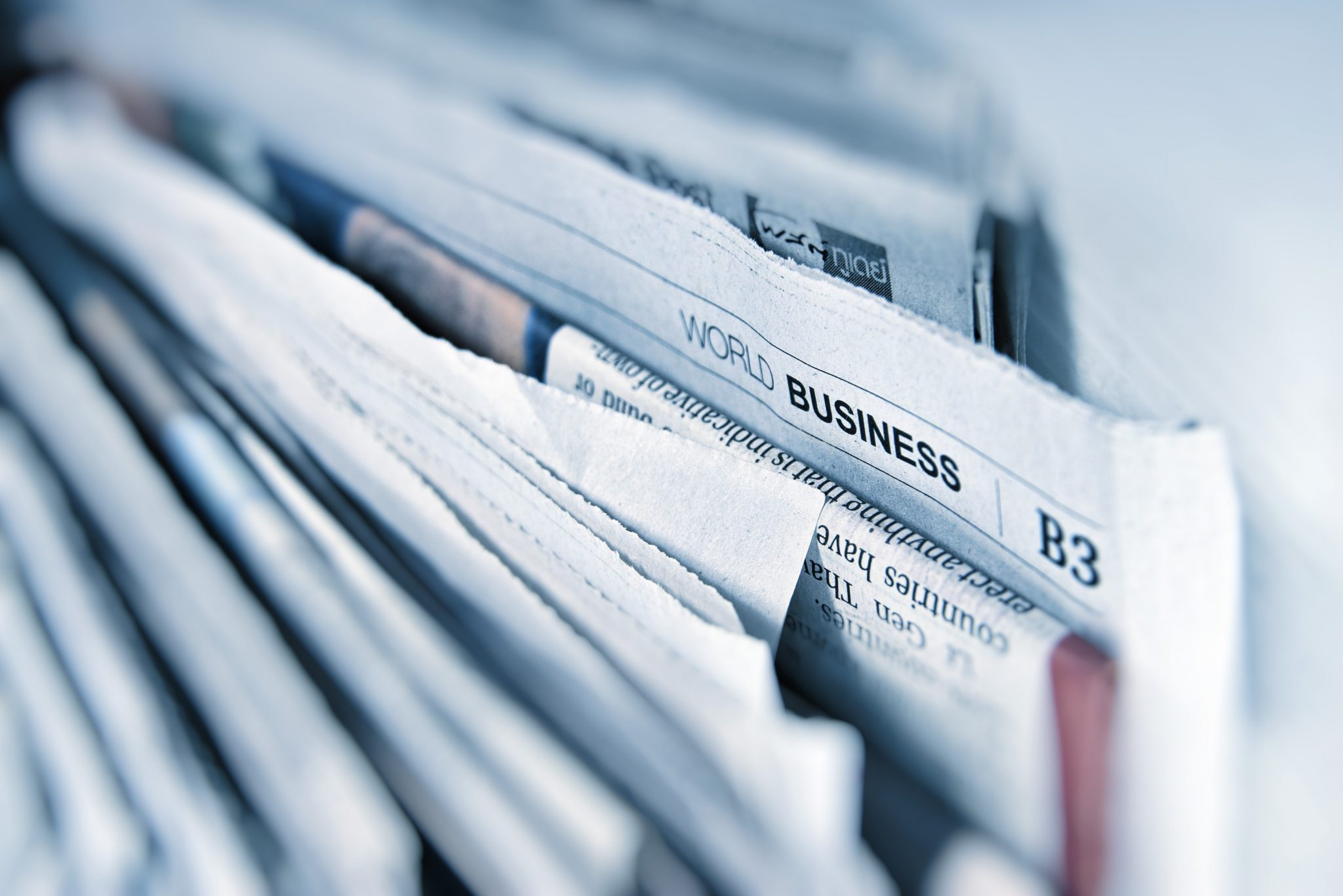 A picture of newspapers with the World Business section emphasised.