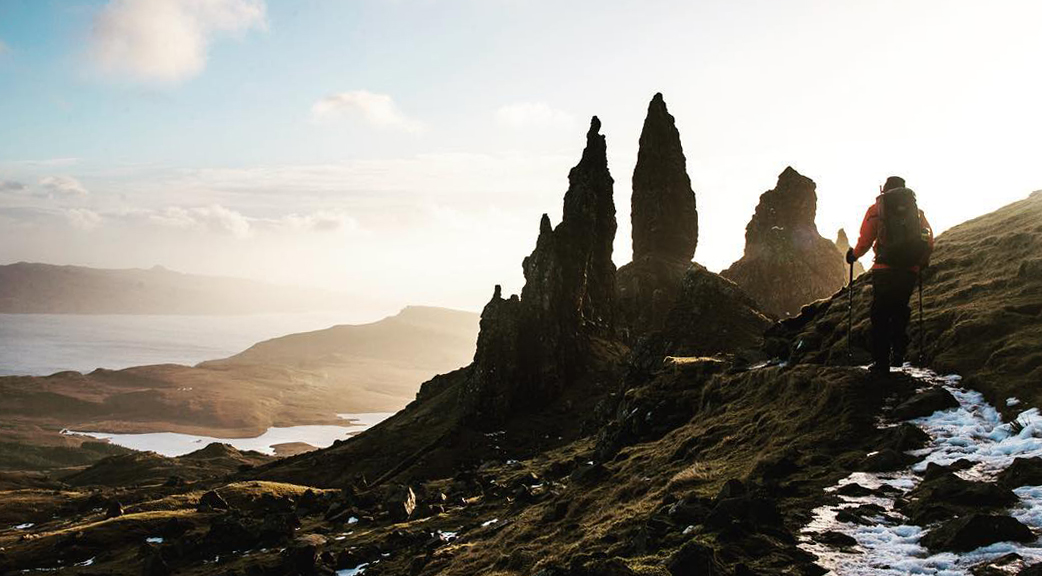 Two trekkers walk towards the Old Man of Storr in the Trotternish on Skye