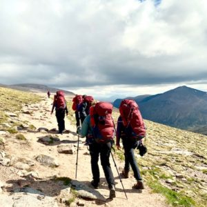 Female trekkers ascend mountain in the Cairngorms