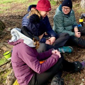 Female trekkers converse at camp during wellbeing trek