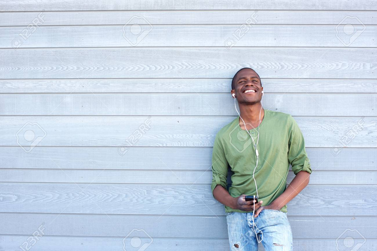 67047998-portrait-of-a-cool-yoyung-black-guy-listening-to-music-with-earphones.jpg