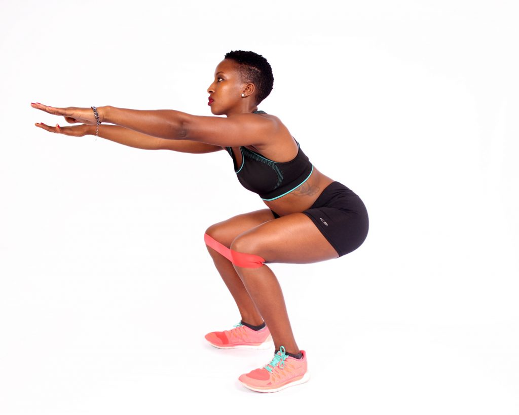 Fit-woman-doing-squats-with-resistance-bands-1024x819.jpg