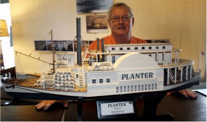 Dennis Cannady with a model of the CSS Planter