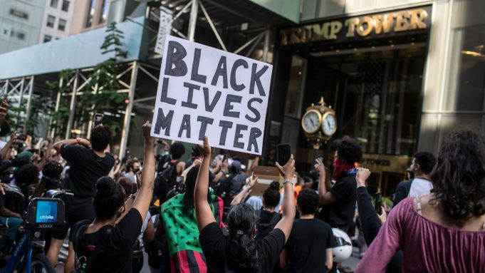 Black Lives Matter banner being held outside Trump Towers