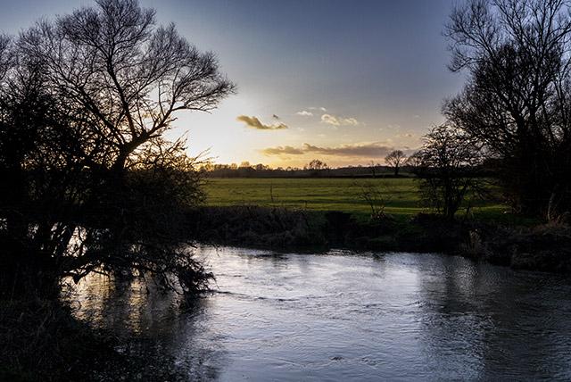 Golden glow across the fields at Cosgrove