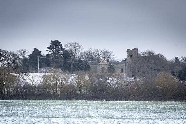 Old Wolverton Church in Light snow