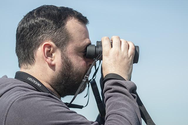 Me using the Opticron Countryman 8×42 BGA HD+ Binoculars (photo by my daughter).