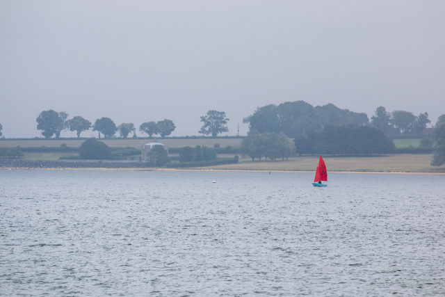 Red Sail boat on Rutland Water