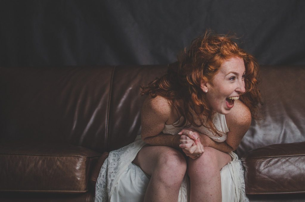 a woman smiling in the sofa