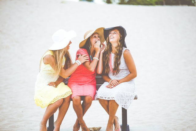 women talking and laughing