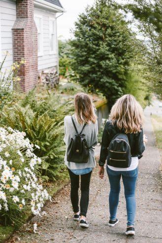 two girls walking outside