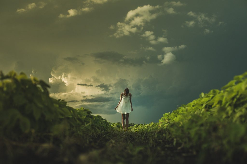 woman standing in the green field