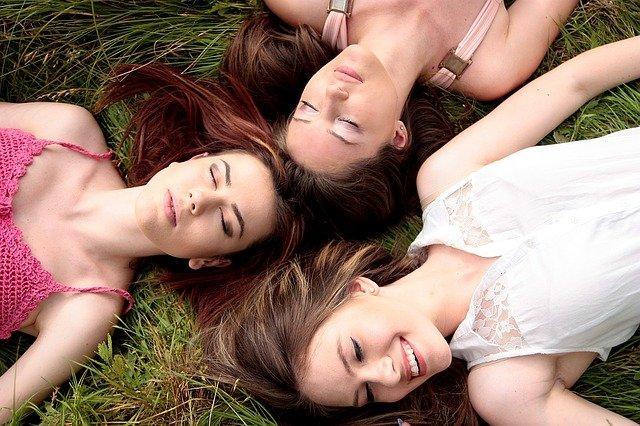 women lying in the ground
