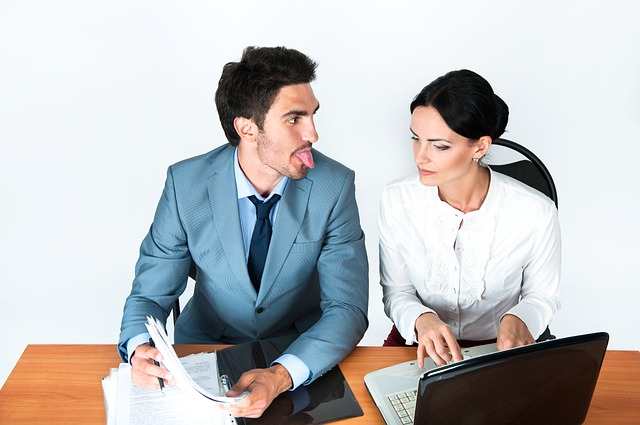 man making face to a woman