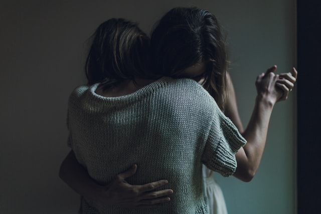 women hugging each other