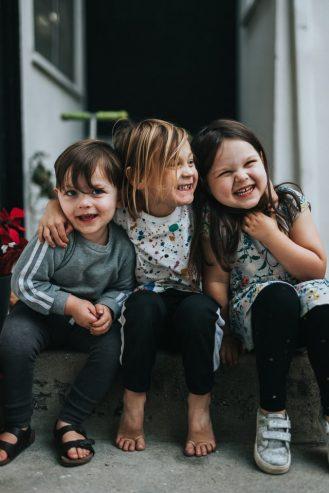 three kids smiling
