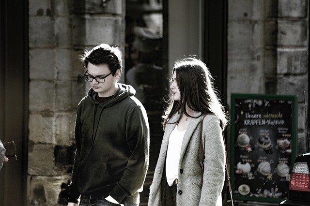 couple having disagreement walking
