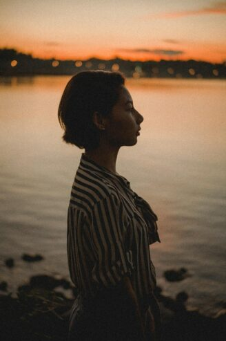 side view photo of a woman during dawn