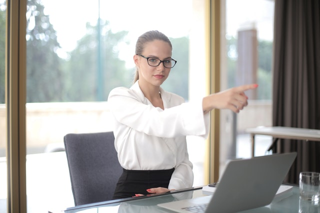 woman pointing away in the office