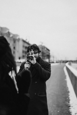 man taking photo of a woman