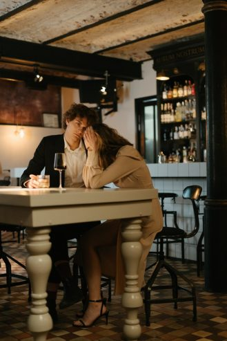 man and woman arguing in a restaurant
