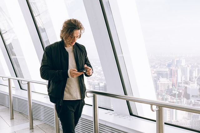 man checking on his phone