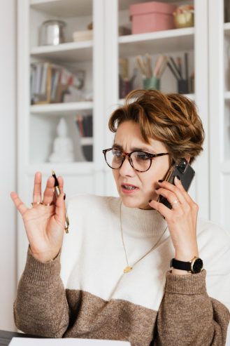 woman talking on the phone with confused face