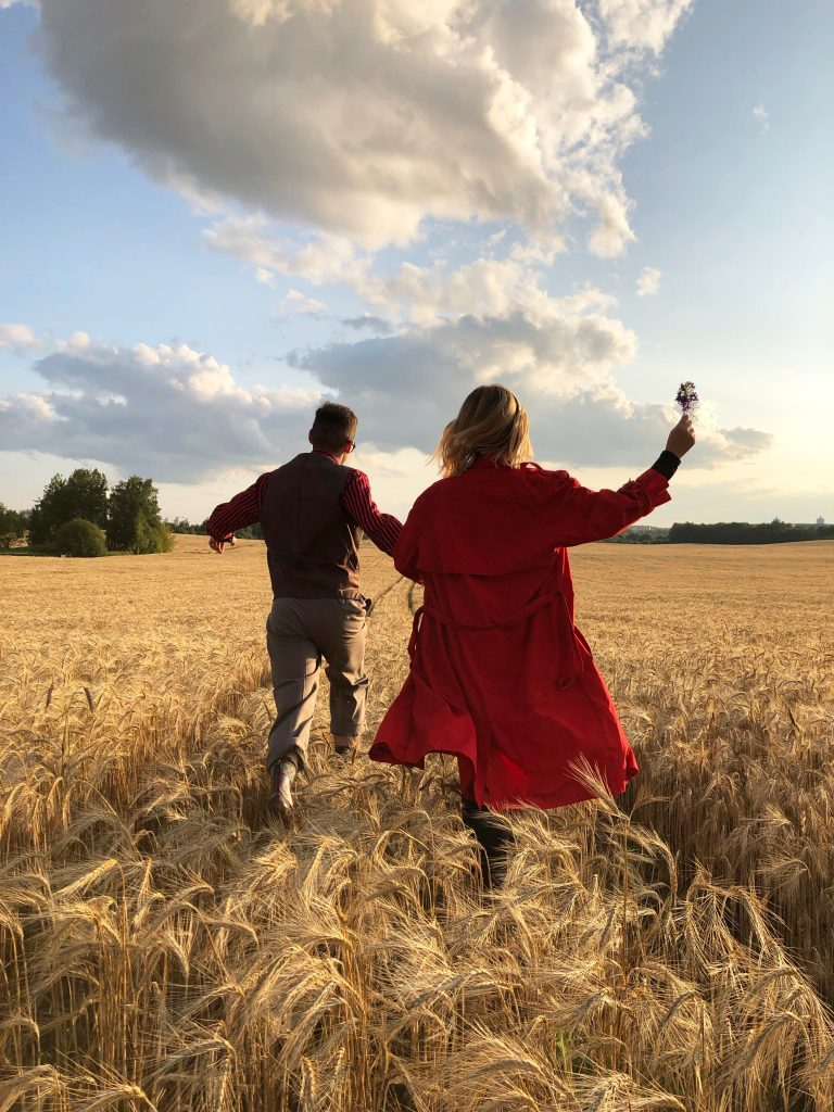 a couple running in a field