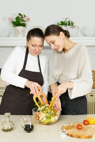 mom and daughter cooking