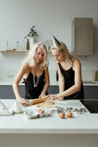 mom and daughter preparing a dough